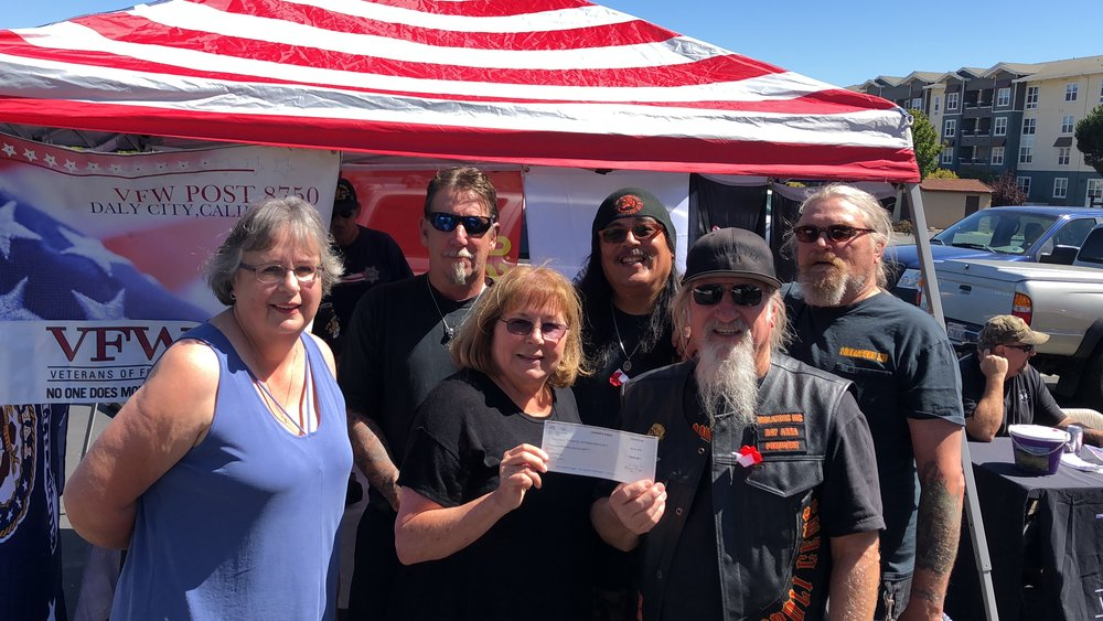 Pictured: Jean Marie Brown, UVS Treasurer; Leslie Buchman, UVS President; Dennis Gilchrist, Violators MC President; Mike Golden, Violators MC; Bobby Tabaldo, Violators MC and Billy Crouse, Violators MC.