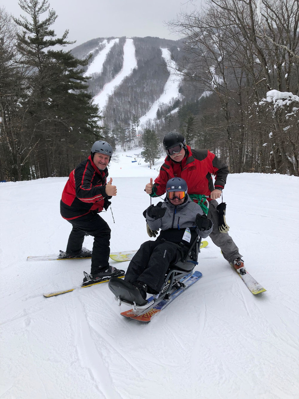 Navy veteran Kenny and his father are able to be back on slopes together with lessons provided by volunteer Ralph Marche. UVS donations to adaptive sports makes these activities possible.