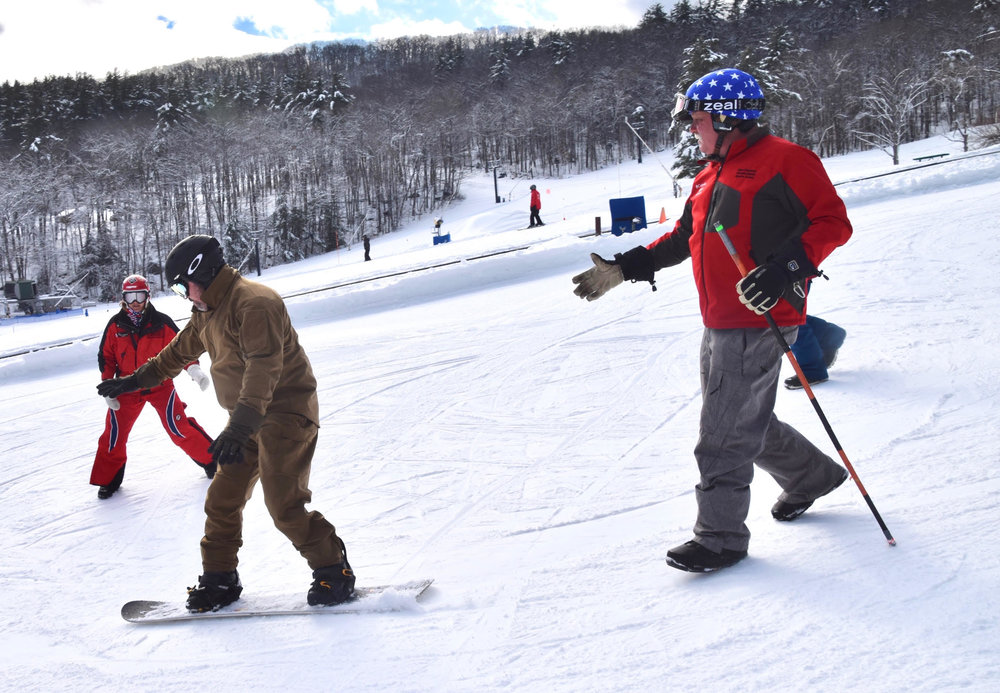 Giving freedom back to Army Veteran John through snowboarding. John has an above knee left leg amputation and utilizes a knee with air pressure shock absorbers. Advances in prosthetic devices has increased the activity levels of our recently injured veterans.