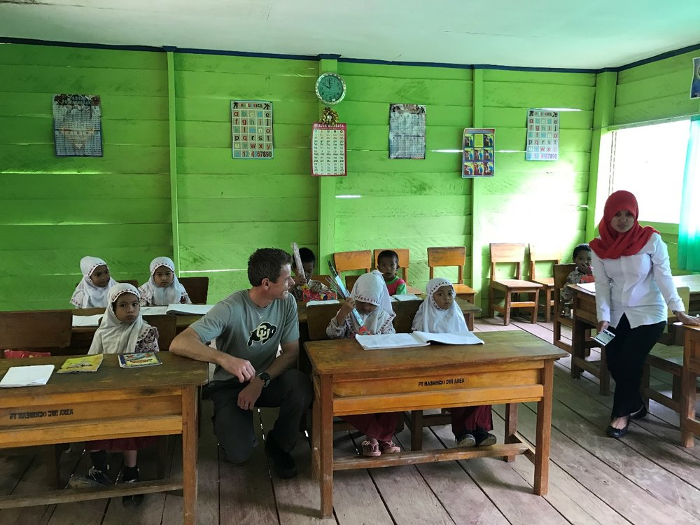 Nusantara CFO Craig Smyth talking to children at school