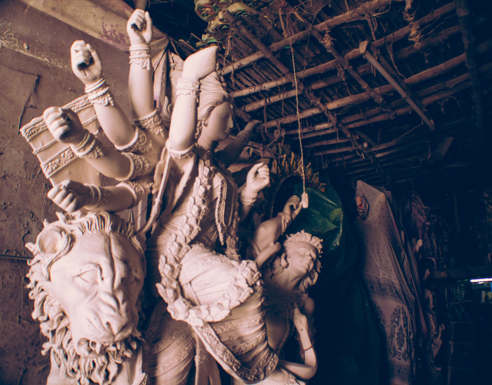A partially finished sculpture awaits her finishing touches inside an artist's warehouse in Kumartuli,days before the start of the festival.