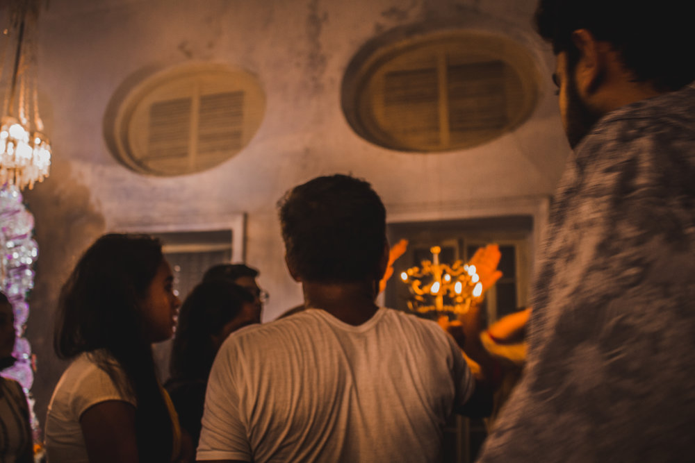 Visitors seek blessing from the flames after  arati, a ritual where the idol is worshipped with the flames from a lamp.