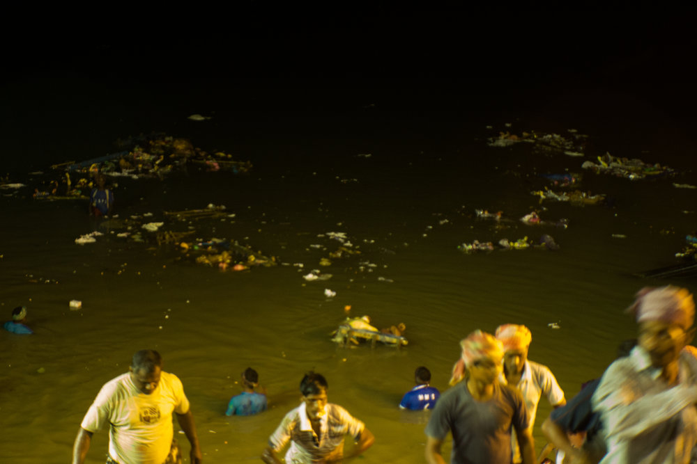 Once the idol sinks into the water, the clay disintegrates, leaving behind a trail of old garlands and ornaments to float along with other debris and waste thrown into the river.
