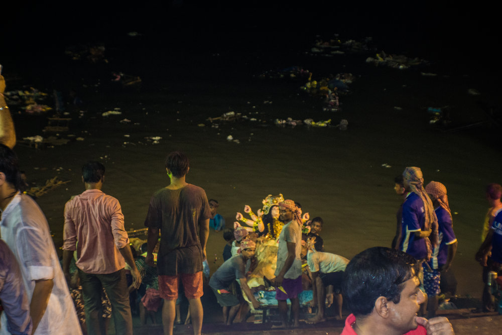 An idol is submerged into the Ganges on the tenth and final day of the Durga Puja.