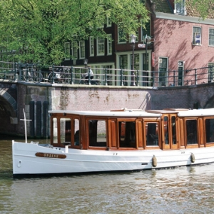 Private canal cruise - Through the beautiful canals is so romantic to do! You will be picked up by a saloon boat near CoHo Suites and showed around Amsterdam by a private skipper on a boat enjoying a glass of wine (available upon request).