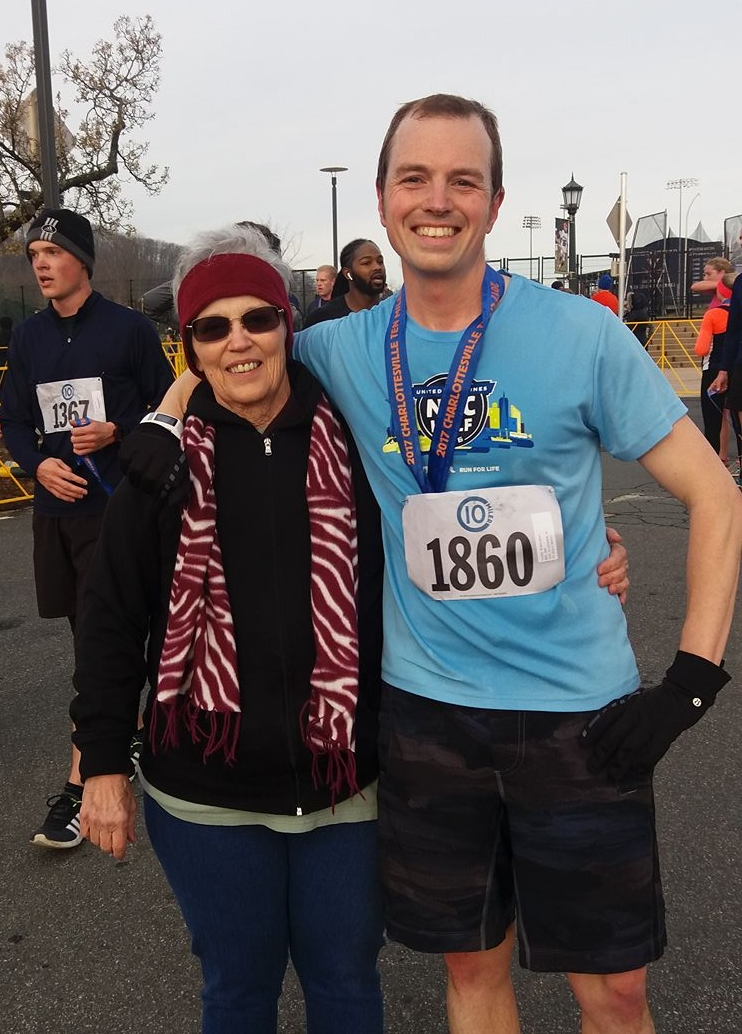 Celebrating my first sub-70 minute 10 Miler with Ma Walsh.