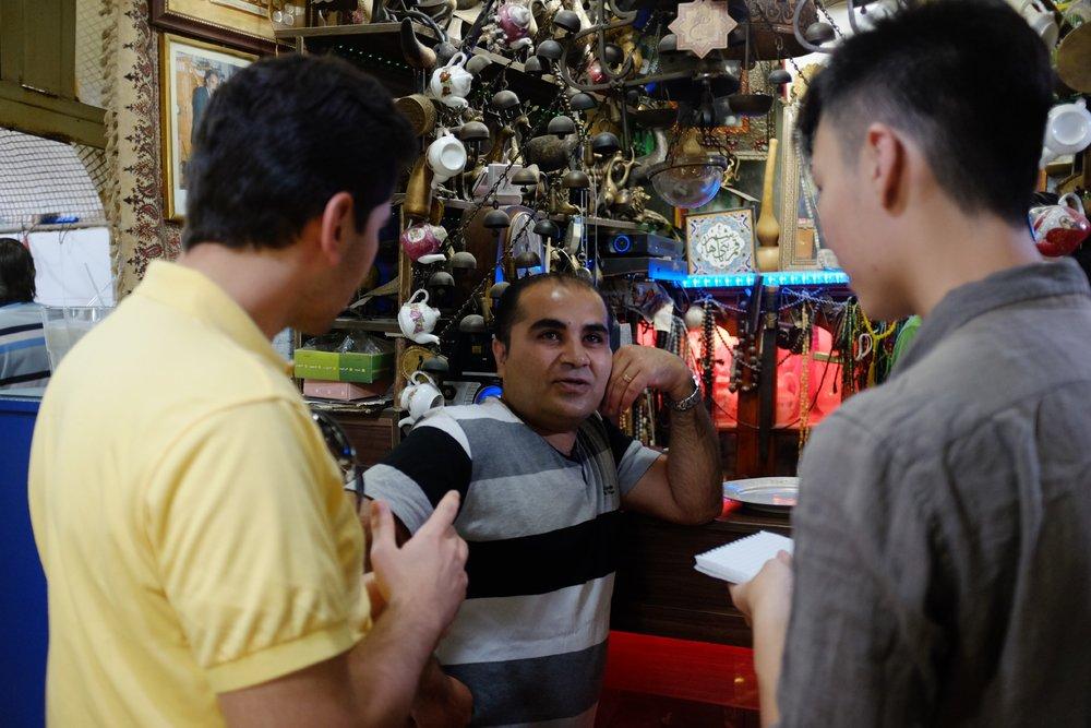 Xue Qiang conducting an interview in Iran.