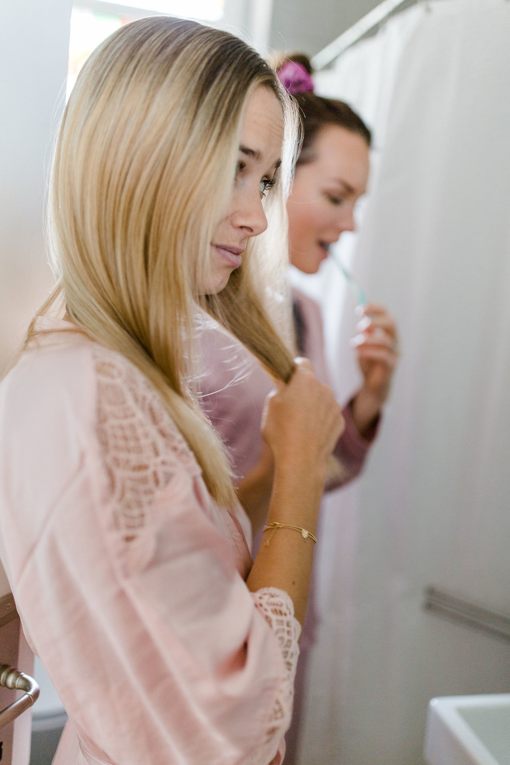 My luxury linen two girls in bathroom getting ready for evening