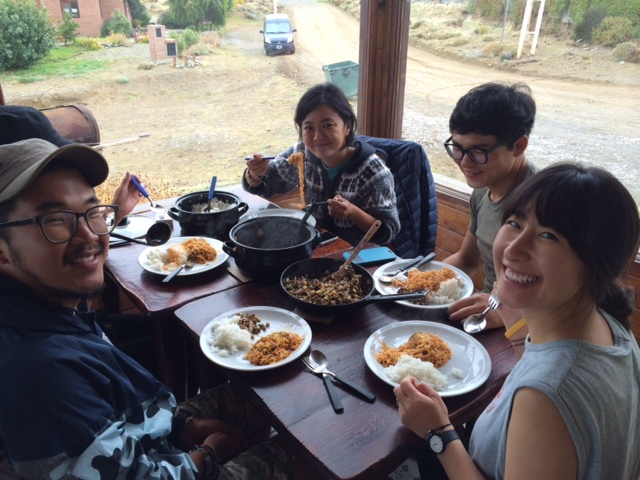 A group of friends at the hostel enjoying their lunch