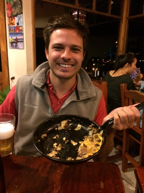 A Brazilian we met at the hostel, with his hearty dinner omelet