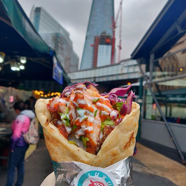 [insert mandatory food shot in front of the shard]  Koji Chicken flatbread, fennel kimchi, daikon kohlrabi salad, pickled chillies hot sauce and yoghurt. In a bread. @boroughmarket today until 6