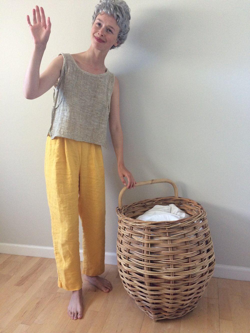 me in a very lightweight woven cotton top  two months later I got rid of this beautiful laundry basket - not practical.