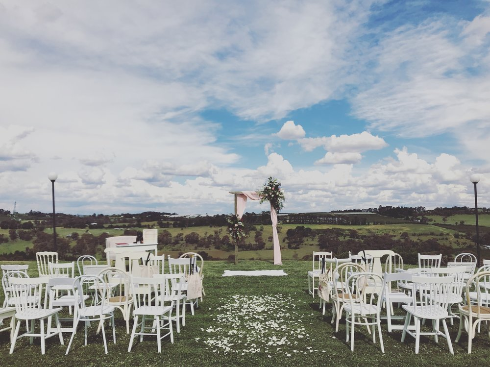 White Eclectic Chairs // Photo by Bespoke Country Weddings