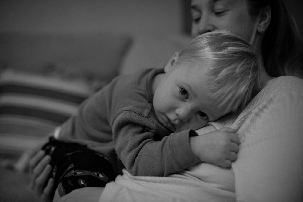 Toddler snuggling with mum