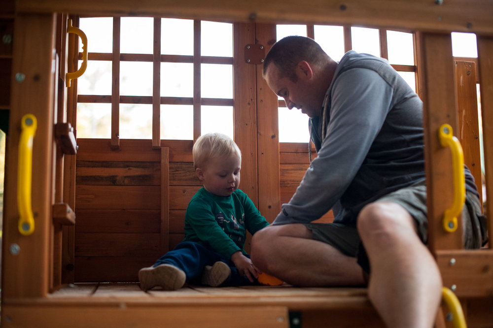 father and son picnic in cubby house
