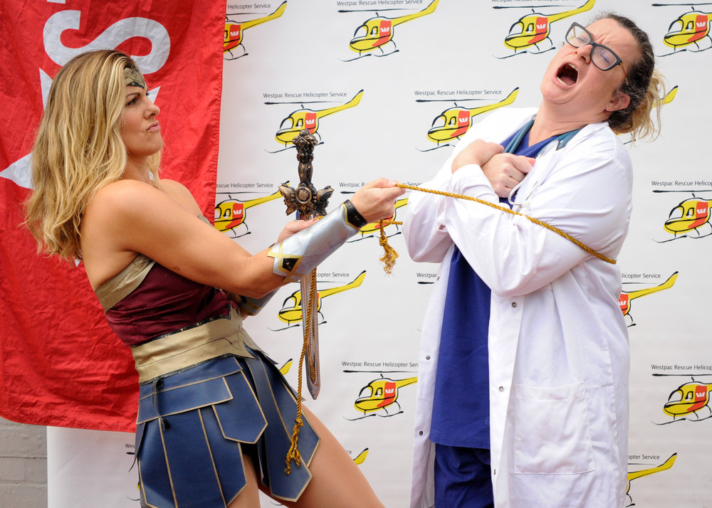 Wonder woman and the crazy doctor getting ready for the big jump