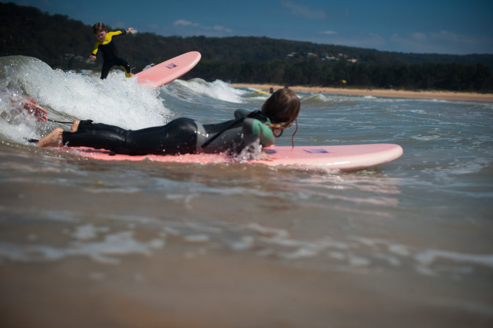 Little boy surfing Umina Beach Central Coast NSW