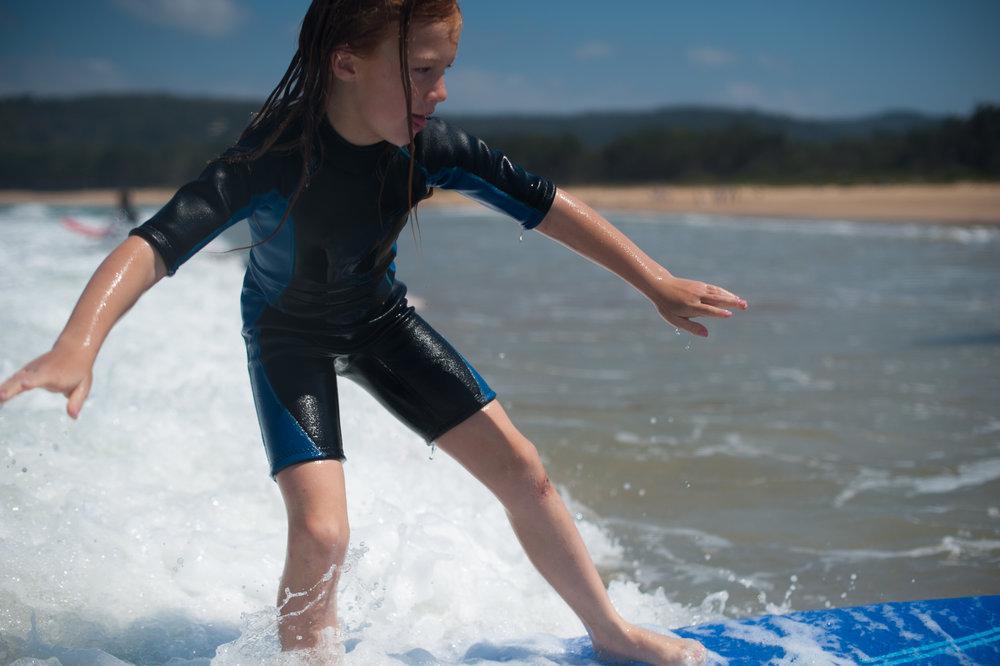 Girl surfing Umina Beach