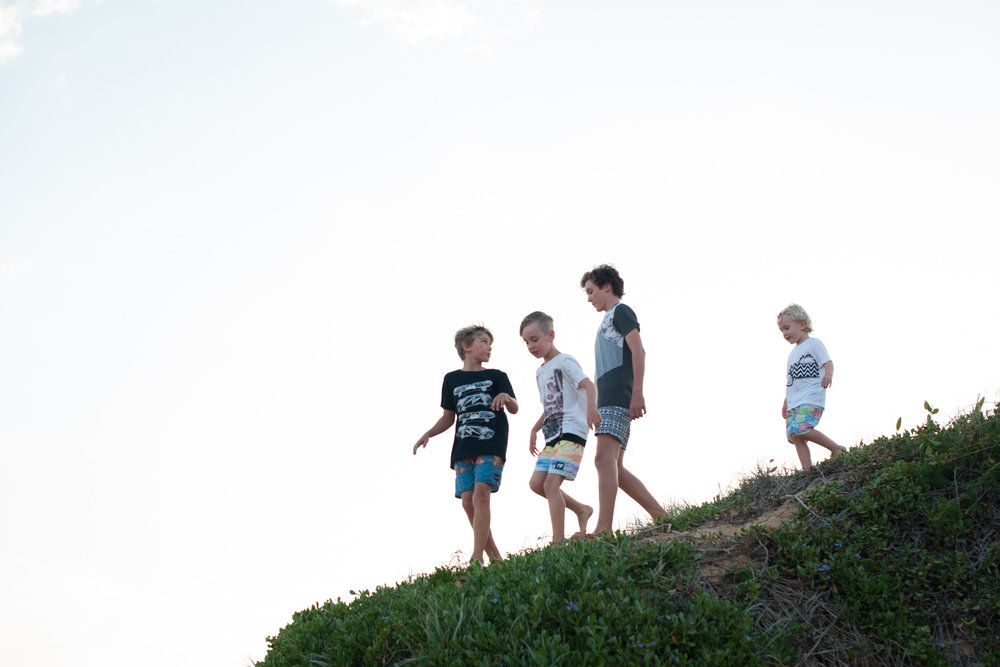 central coast family photographer boys playing in sand dunes