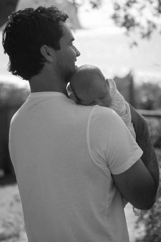 father holding newborn baby macmasters beach nsw