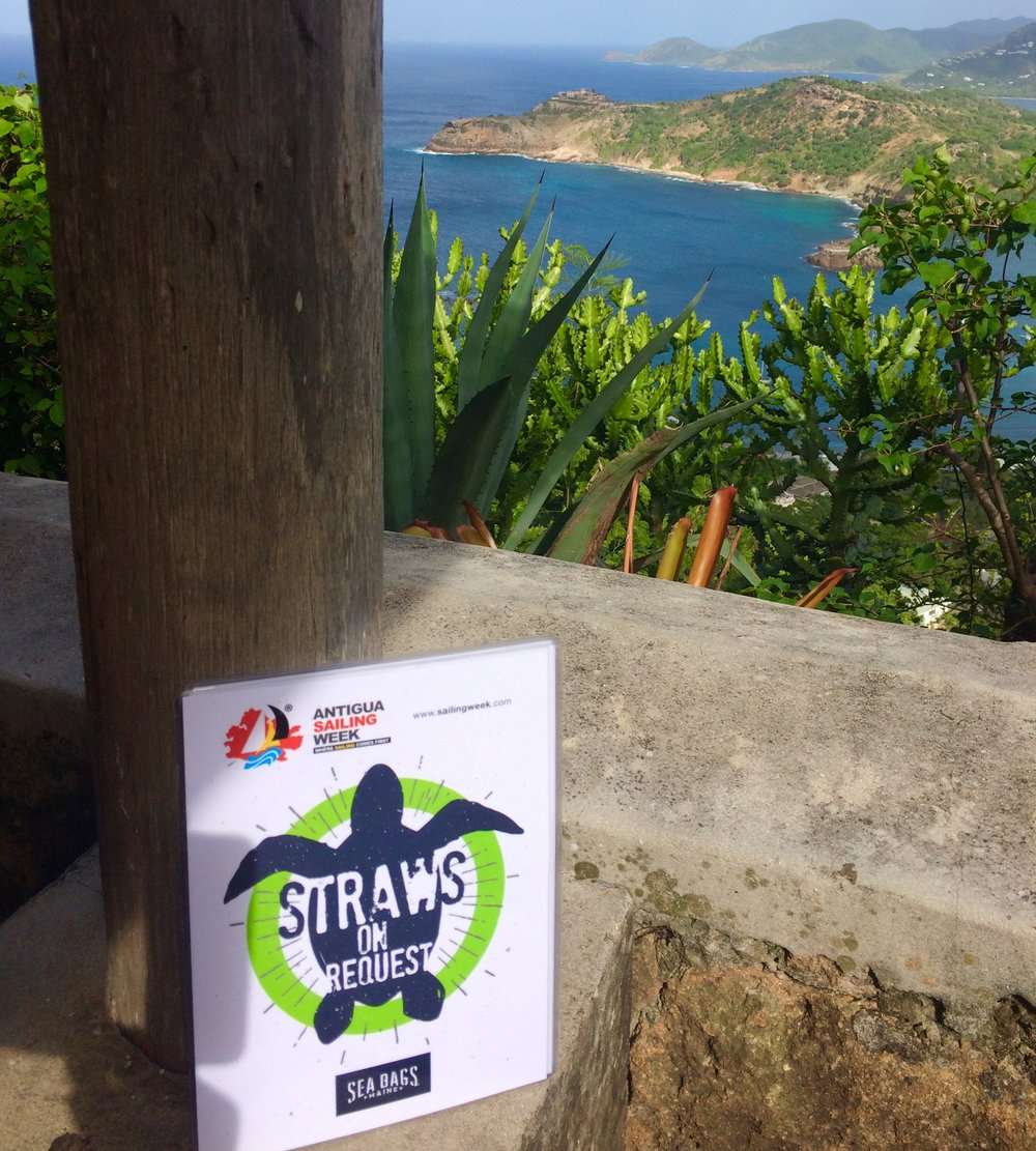 Signs of Success at Antigua Sailing Week, letting regatta attendees know that straws are available by request only. With views like these, who wouldn't want to keep them plastic pollution free! 👍 🌊 Photo by Alison Sly-Adams