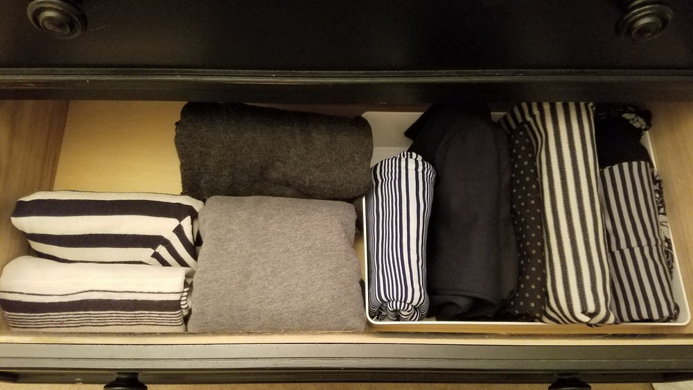 Sweaters + Skirts - Sweaters on the left, skirts in a container on the right.