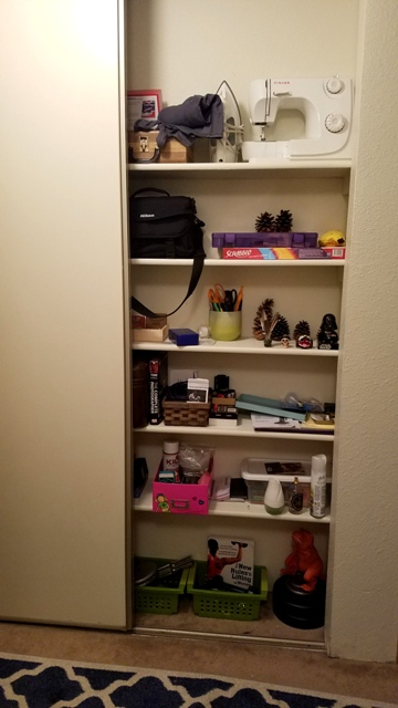 Shelving on other side of coats