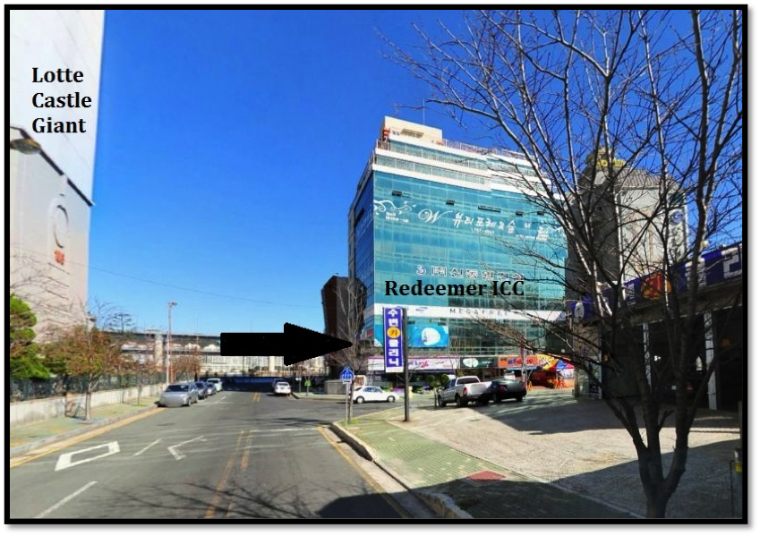 "Cross the road, turn right, and walk towards the corner. Redeemer is one block down on the 3rd floor of the Sky Building. The outside says ""MEGAFREE"" and the building is next to Angel-in-Us Coffee Shop. The first floor has a Blueberry Convenience Store."