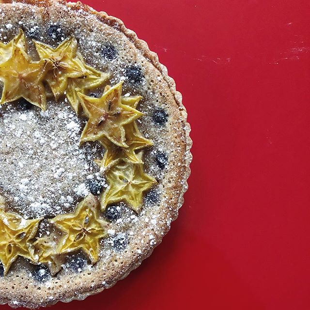 Now and then, in the development of new recipes and concepts, we are reminded of the importance of tenacity. Our new blueberry-starfruit frangipane tart was...a labor of love in every way. . Fresh apricot jam is layered beneath an almond pastry cream in a tender crust, adorned with fresh fruit, then baked to indulgent perfection. It is sure to be the star of your occasion! Special order only. . . . #tart #frangipane #dessert #foodie #foodporn #desserts #dessertporn #food #baking #ganache #pastry #pastries #buzzfeast #trueABQ #artisan #feedfeed #huffposttaste #foodgawker #sweetmagazine #droolclub #foodprnshare #kitchenbowl #gloobyfood #starfruit #blueberry