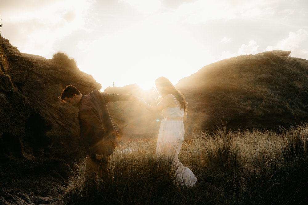 They have found me through  google  to do their  engagement shoot . Hope they hire me as their  Wedding Photographer  as well. This was shot at  Piha beach, Auckland, New Zealand  during sunset as the light is just outstandingly soft. If you are looking for a  wedding photographer in Auckland  I'm the one, As I'm aiming to be one of the  top wedding photographer  in  Auckland . I offer  affordable wedding photography services in Auckland  which is stylistic, documentive and moody. If you need to  hire a wedding photographer,  I can take on any  Auckland Venue / venues.