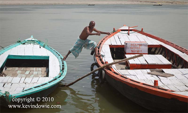 Stepping between boats,  River Ganges at Varanasi.