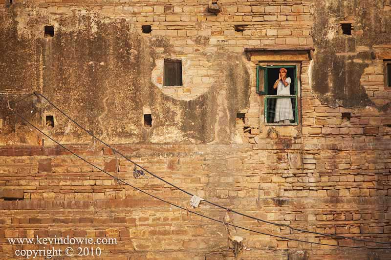 Woman at the window, Varanasi, India.