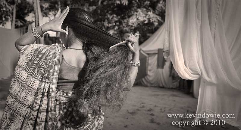 Woman brushing her hair, Haridwar, India. (monochrome)