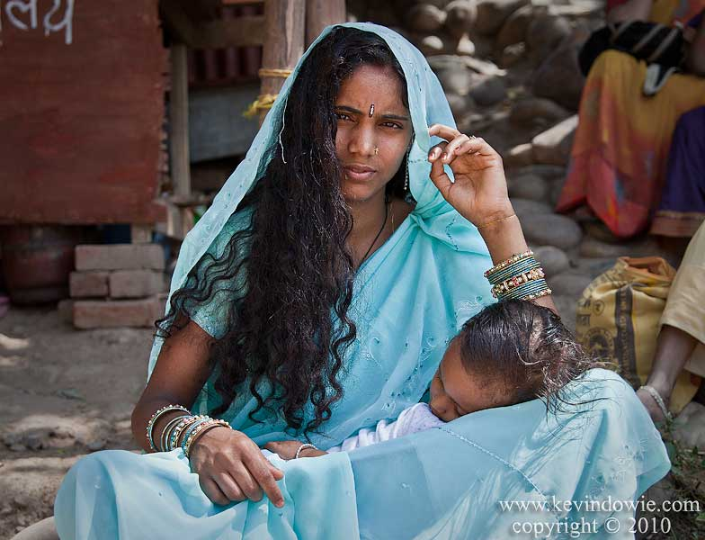 Young mother with child, Haridwar, India.