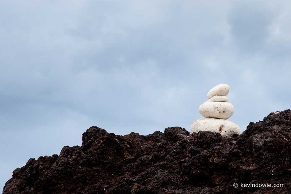 White stones stacked on black lava rock, Big Island, Hawaii