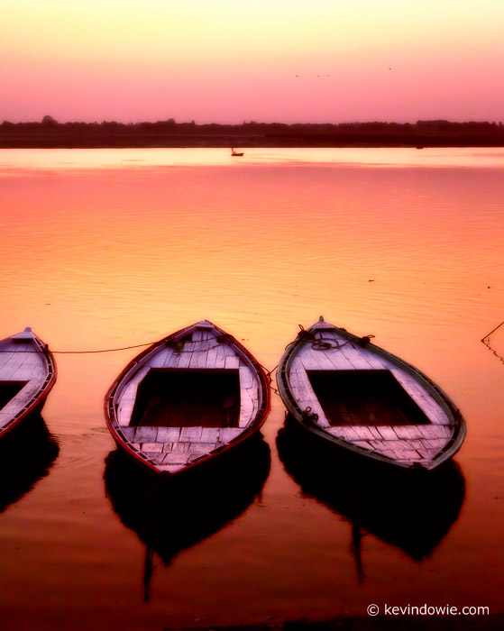 Boats on the Ganges at sunrise, Varanasi, India. (CFX processing)