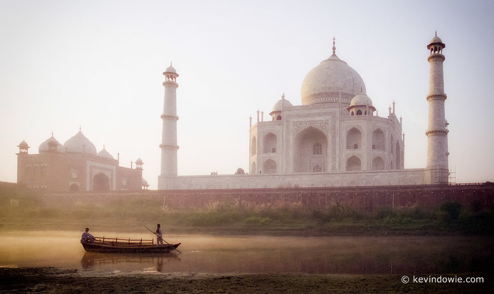 Boatmen at dawn, Taj Mahal, India.