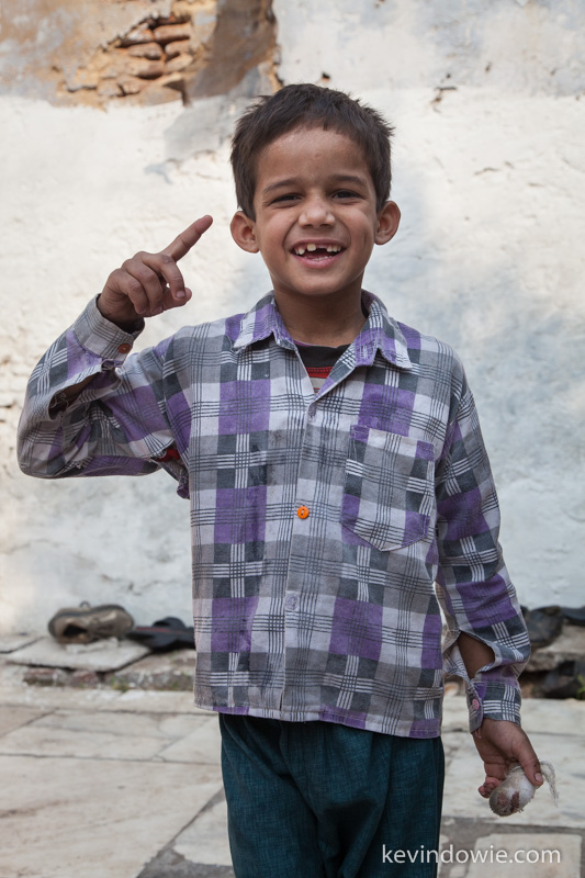 """One photo"" a young boy insists on being photographed at Nizamuddin."