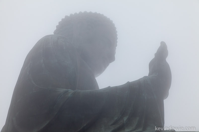 Almost silhouetted, Giant Buddha in fog.