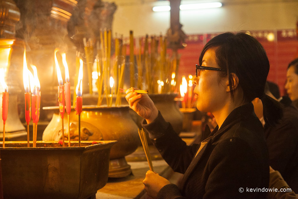 Lighting incense sticks, Man Mo Temple, Hong Kong
