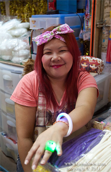 The lady with the plastic ring, Bangkok, Thailand
