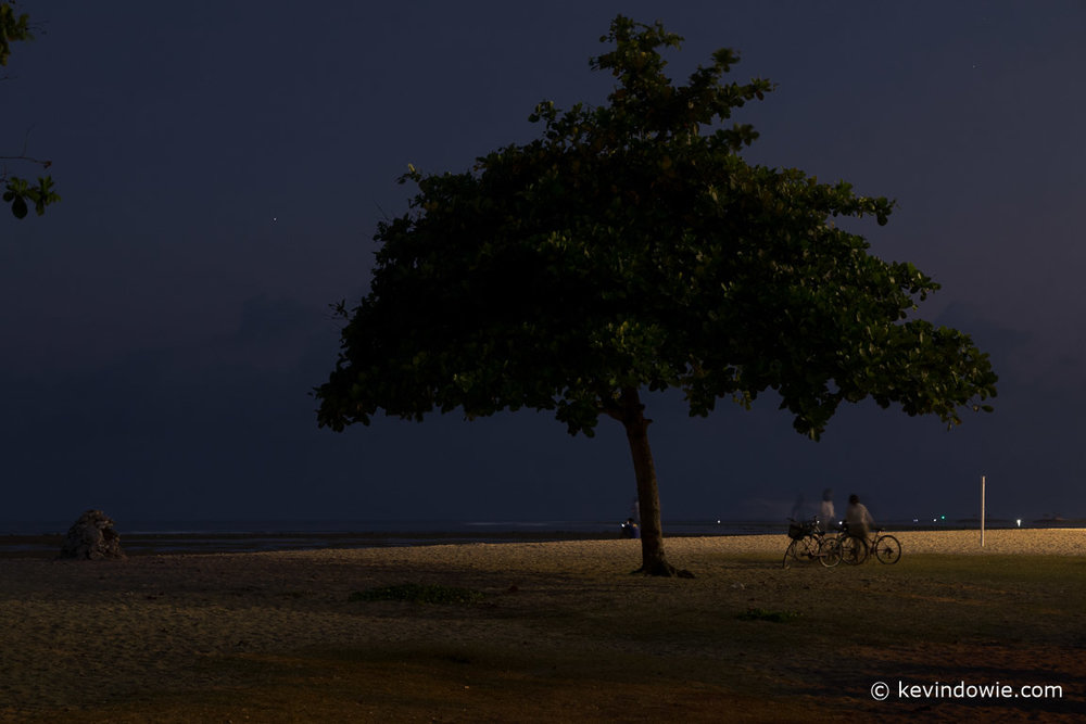 Collecting the bicycles, Sanur Beach, Bali.