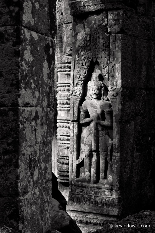 Apsaras are generally seen as dancing maidens. This figure is more correctly a Devata, or temple guardian. Ta Prohm temple.
