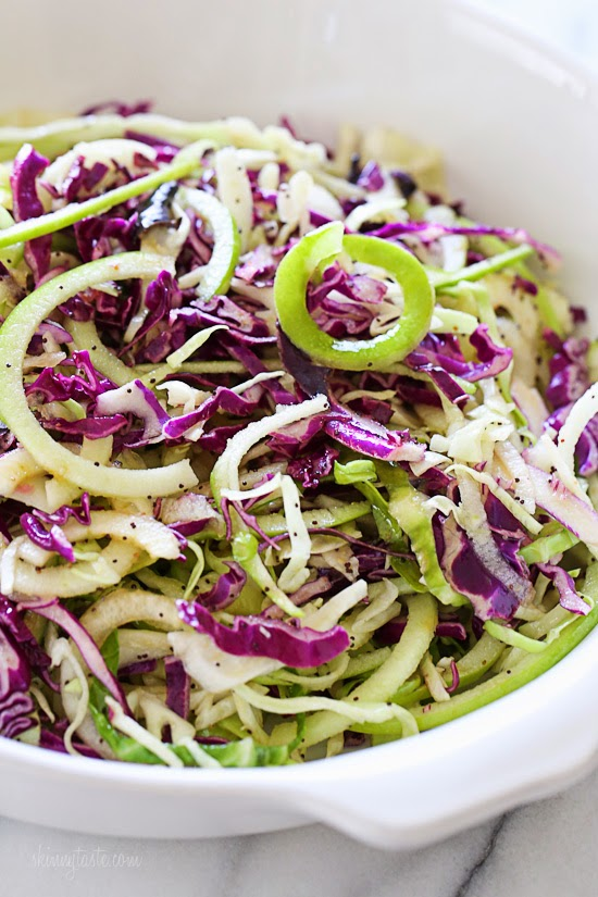 SPIRALIZED APPLE SLAW WITH POPPY SEED DRESSING - Spiralized Apple Slaw with Poppy Seed DressingApple plus cabbage slaw equals delicious. The combination of tart-yet-sweet apple with cabbage, topped off with poppy seed dressing will leave you very satisfied. And the best part is that it's quick and easy to make, and each serving has 98 calories. And for more flavor, add some Manchego cheese. (You'll thank me once you're licking your plate clean!) Skinny Taste