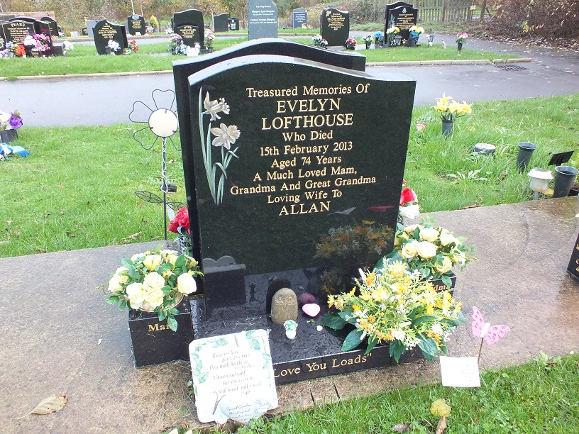 Half Ogee Black polished granite headstone- with daffodil design