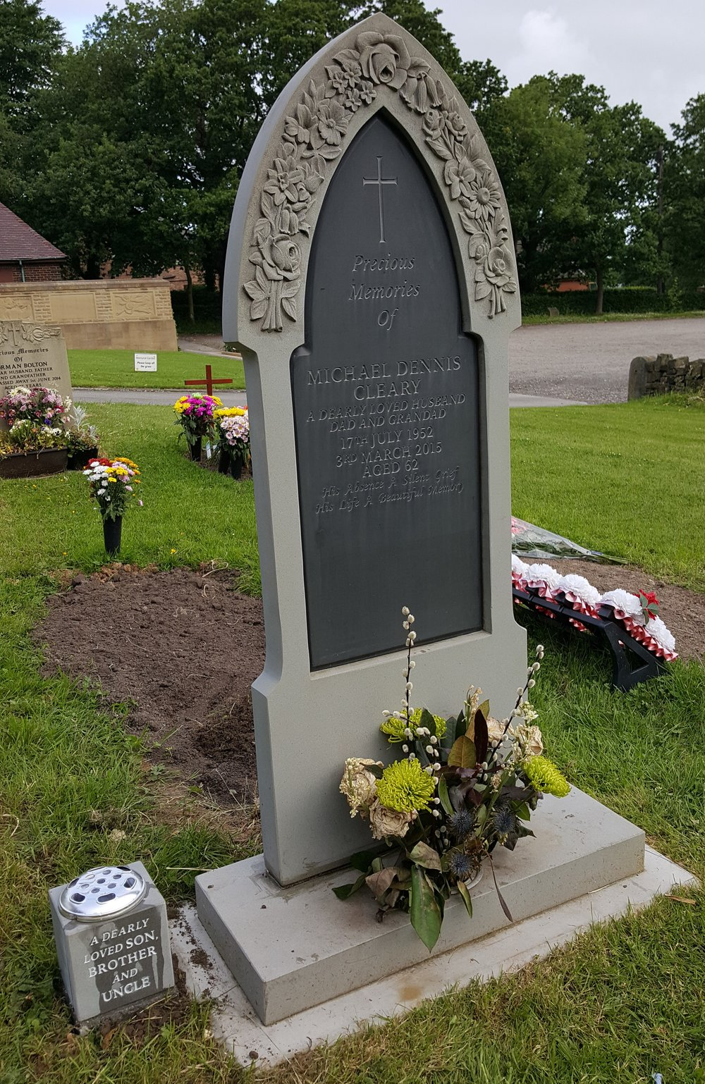 Gothic shaped limestone memorial with slate tablet