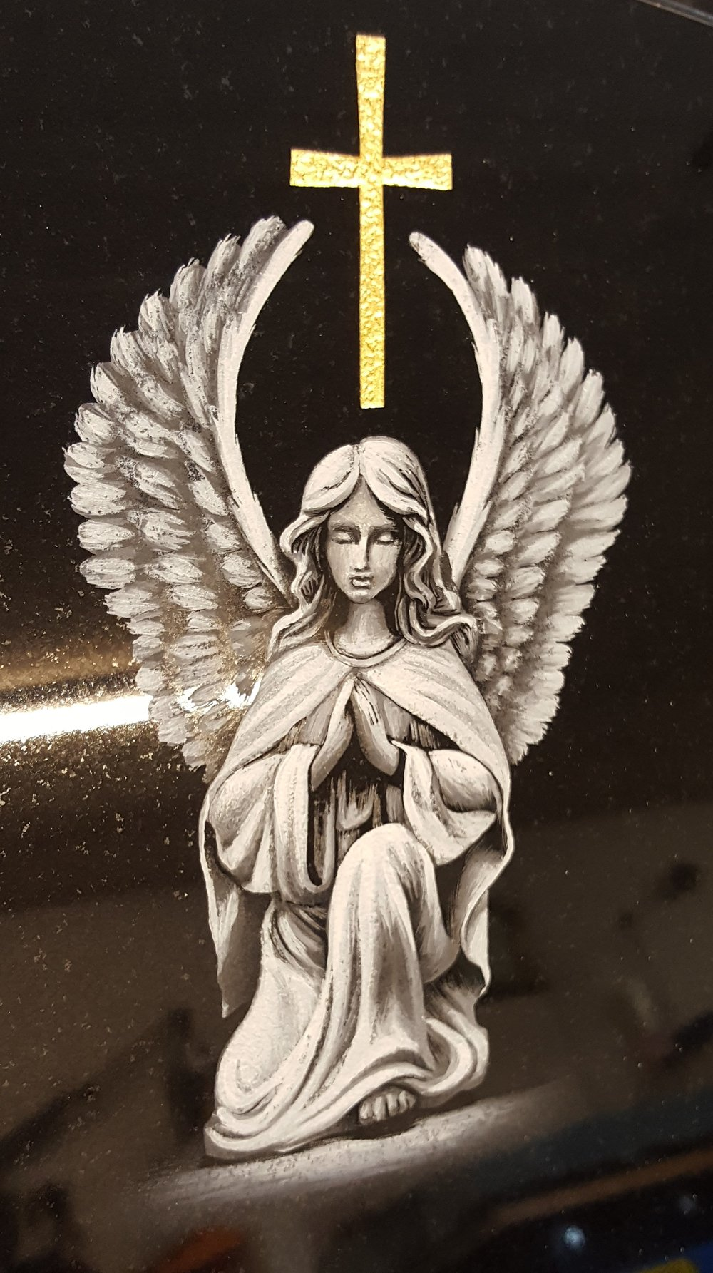 Angel and gold cross