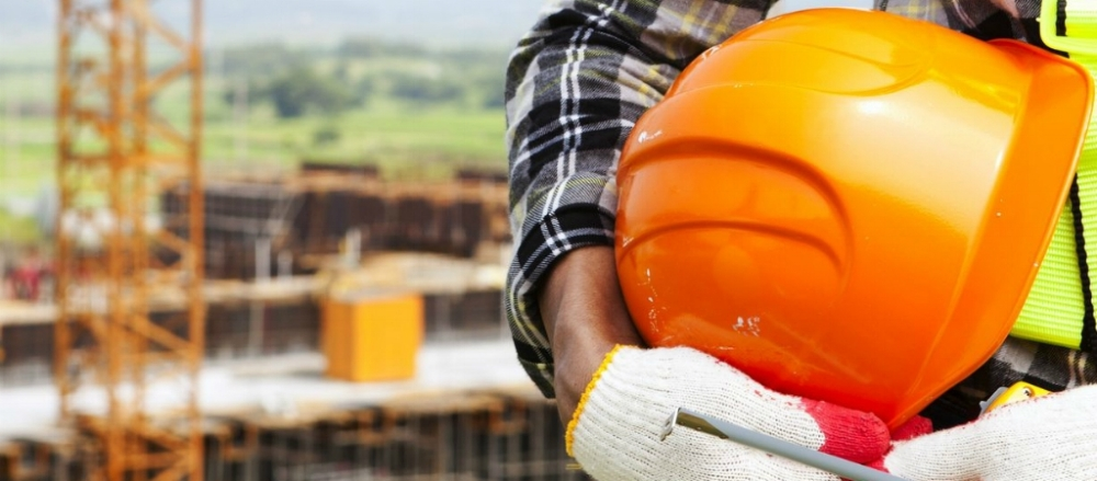 Man on construction site wearing safety equipment.jpg