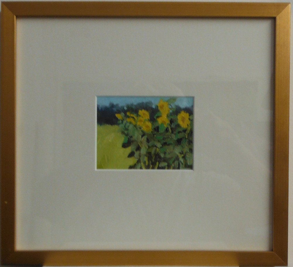 "All Moments come framed as pictured above.  ""Sunflowers"""