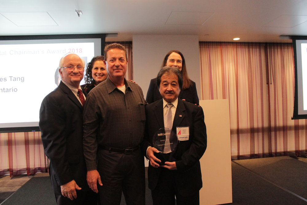 2018 Chairman's Award Winner James Tang pictured with President Rachel Howitt, COO Michele Stein, CEO Tim Foutz and Executive Managing Director John Boyer.